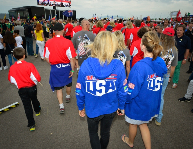 The 31 rider US ISDE Team and their support crews walk into the Opening Ceremonies area Saturday night.